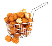 Chicken Popcorn In A Small Wire Frying Basket. Fried breadcrumb covered chicken popcorn in a small wire frying basket isolated on a white background royalty free stock photo