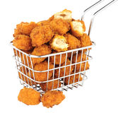 Chicken Popcorn In A Small Wire Frying Basket. Fried breadcrumb covered chicken popcorn in a small wire frying basket isolated on a white background royalty free stock image