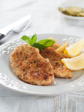 Chicken or pork schnitzel stock images