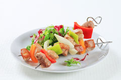 Chicken and pork skewers Stock Image