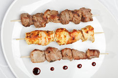 Chicken,  pork and veal kebab on white plate. With sauce Stock Photography