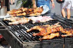 Chicken portions on smoking grill, street food Royalty Free Stock Photos