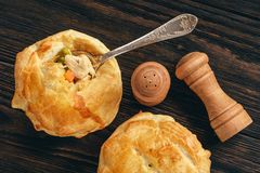 Chicken pot pie with carrot, grean peas and cheese. royalty free stock images