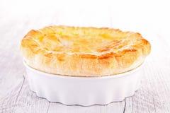 Chicken pot pie. On wood stock photos