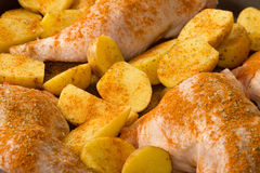 Chicken with potato wedges Stock Images