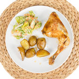 Chicken with potato wedges and salad Stock Photos