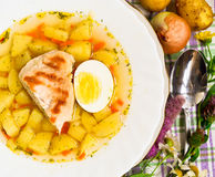 Chicken potatoes soup. Country chicken potatoes vegetables soup Royalty Free Stock Photography