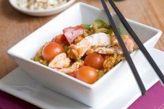 Chicken and prawn paella Stock Image