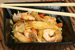 Chicken and prawn stir fry. With singapore noodles stock image
