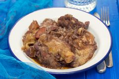 Chicken prepared with red wine in white plate Royalty Free Stock Image
