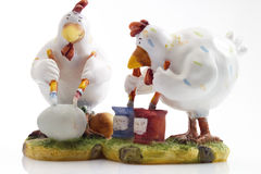 Chicken preparing to paint Easter eggs, figurine Stock Images