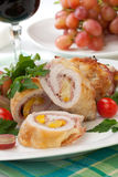 Chicken Prosciutto Roulade. Tasty chicken prosciutto roulade stuffed with cheese and pineapple, served with baby kale, grapes, and cherry tomatoes salad Stock Image