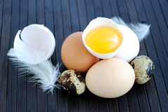 Chicken and quail eggs on bamboo mat Royalty Free Stock Photos