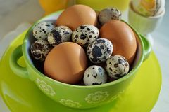 Chicken and quail eggs in colorful porcelain dish. Easter Stock Photo