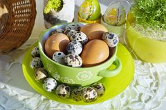 Chicken and quail eggs in colorful porcelain dish. Easter Stock Photography