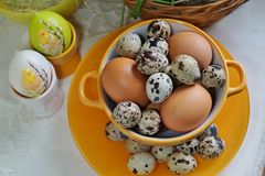 Chicken and quail eggs in colorful porcelain dish. Easter Royalty Free Stock Images