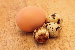 Chicken and quail eggs. On wooden board Royalty Free Stock Image