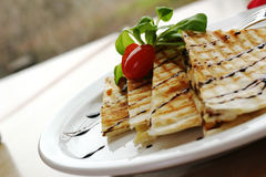 Chicken Quesadilla. Three cheese chicken quesadilla, drizzeled with balsamic vinager. Shallow DOF stock image