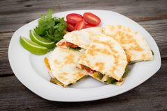 Chicken quesadilla dish. On wooden rustic table stock image