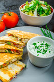 Chicken quesadilla. With tomato, red onions, parsley and red pepper, fresh salad and creame sour-chive dip Stock Photos