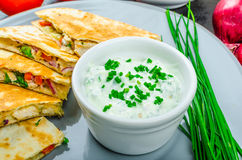 Chicken quesadilla. With tomato, red onions, parsley and red pepper, fresh salad and creame sour-chive dip Royalty Free Stock Photography