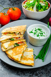 Chicken quesadilla. With tomato, red onions, parsley and red pepper, fresh salad and creame sour-chive dip Stock Images