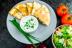 Chicken quesadilla. With tomato, red onions, parsley and red pepper, fresh salad and creame sour-chive dip Stock Image