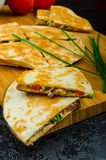 Chicken quesadilla. With tomato, red onions, parsley and red pepper, fresh salad and creame sour-chive dip Royalty Free Stock Photo