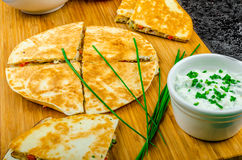 Chicken quesadilla. With tomato, red onions, parsley and red pepper, fresh salad and creame sour-chive dip Stock Photography