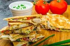 Chicken quesadilla. With tomato, red onions, parsley and red pepper, fresh salad and creame sour-chive dip Royalty Free Stock Images