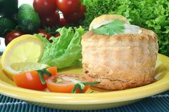 Chicken ragout. Queen pie filled with chicken ragout and fresh herbs Royalty Free Stock Photo