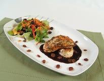 Chicken with raisin sauce. Grilled chicken with fresh raisin sauce stock photo