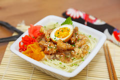 Chicken ramen. Topped with roast chicken, egg and pickles Royalty Free Stock Photo