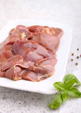 Chicken raw liver in a white plate. On a white background Royalty Free Stock Photos