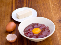 Chicken raw liver and yolk Stock Images