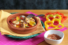 Chicken with red and yellow peppers Royalty Free Stock Photography