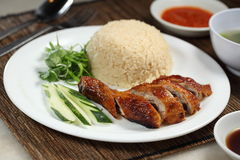 Chicken Rice. Chinese roast chicken rice with butter rice Stock Photos
