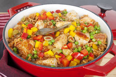 Chicken with Rice Arroz Con Pollo. Chicken and rice dish, arroz con pollo, from Latin America, with chicken, rice, beer, tomatoes, capsicums, peas, paprika Royalty Free Stock Images