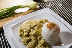 Chicken and rice in curry spice. Chicken in curry spice with rice and wine Royalty Free Stock Photos