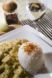 Chicken and rice in curry spice. Chicken in curry spice with rice and wine Royalty Free Stock Photo