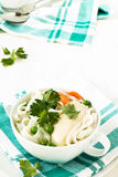 Chicken and rice  noodle soup  with peas Royalty Free Stock Photo
