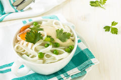 Chicken and rice  noodle soup  with peas Stock Images