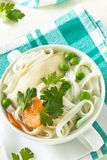 Chicken and rice  noodle soup  with peas Royalty Free Stock Photography