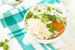 Chicken and rice  noodle soup  with peas Stock Photos