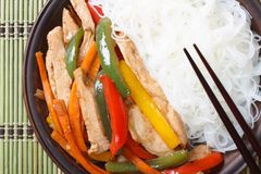 Chicken and rice noodles with chopsticks. top view horizontal Royalty Free Stock Photo