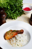 Chicken with rice and pesto on a plate still life Stock Photo