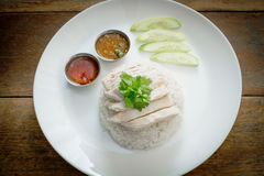 Chicken rice. On rustic wood Stock Photos