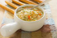 Chicken rice soup with bread stick Royalty Free Stock Image