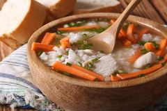 Chicken rice soup close up in a wooden bowl. horizontal Stock Image