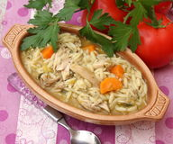 Chicken rice soupe. A stew of chicken meat peas and carrots Stock Photography